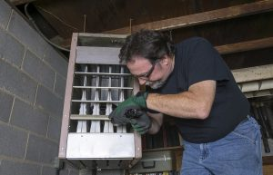 A man performing heating installations in New Orleans, LA