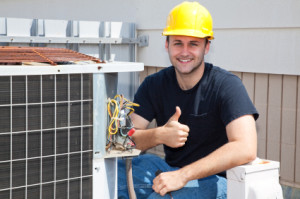 A worker providing professional commercial air conditioning repair in Metairie, LA
