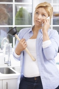 Frustrated Woman Calling Plumber